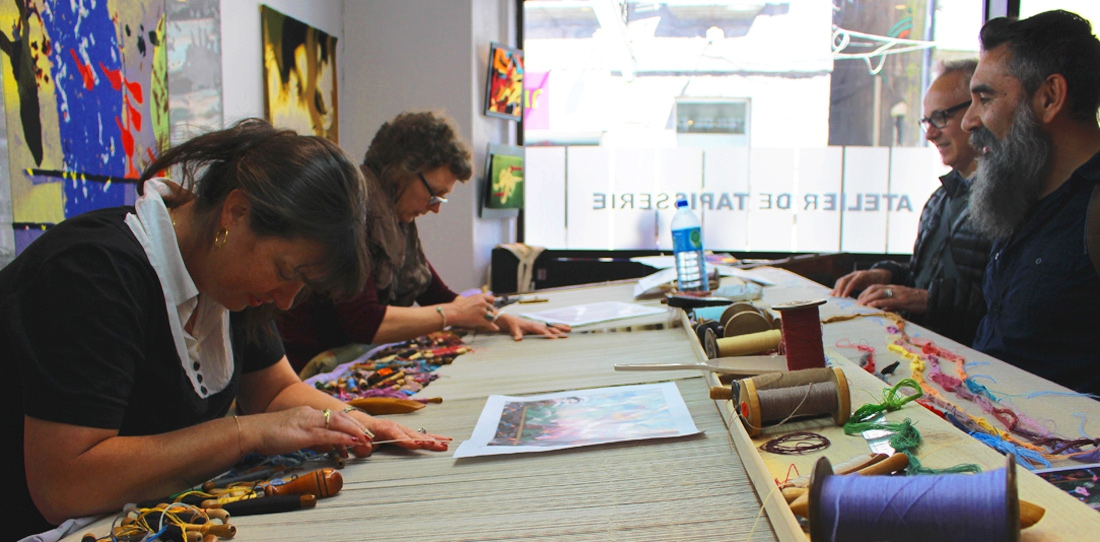 The artists Leo Chiachio & Daniel Giannone discover the weaving in progress of their work